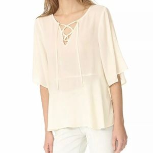 CUPCAKES AND CASHMERE LACE UP FLUTTER BLOUSE IVORY